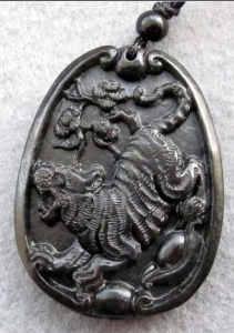 Royal black jade lucky tiger Yuanbao flower amulet